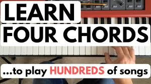 Learn 4 Chords To Play Hundreds Of Songs
